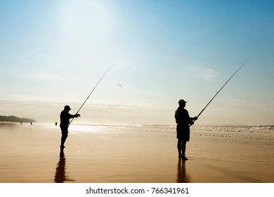 Durban, South Africa - 25. June 2017: Fisherman fishing on a beach alone in St. Lucia, Hluhluwe National Park, near Durban. St Lucia is the fishing Mecca of the KwaZulu-Natal North Coast