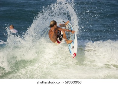 DURBAN, SOUTH AFRICA - 9 MAY 2014: South African professional surfer Travis Logie free surfing in Durban. Logie was on the WSL tour for over a decade and is now the League's commissioner. Editorial.