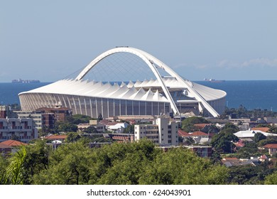 DURBAN, SOUTH AFRICA - APRIL 16, 2017: Urban lanscape against Moses Mabhida stadium and coastal skyline in Durban, South Africa