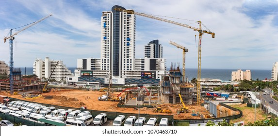 Durban, South Africa, April 9 - 2018: Construction site with construction cranes and the sea in the background. The site is part of a large scale apartments development.