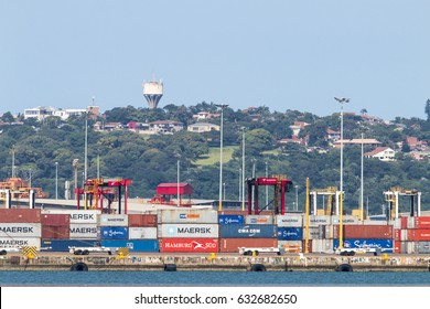 DURBAN, SOUTH AFRICA - APRIL 9, 2017: Containers stacked in Harbor on wharf against straddle carriers, residential district on the Bluff in Durban, South Africa
