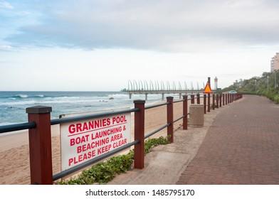 DURBAN SOUTH AFRICA - AUGUST 14 2019: Grannies Pool at the beach and promenade in Umhlanga Rocks near Durban KwaZulu-Natal South Africa