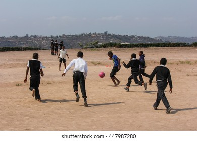 Durban, South Africa - August 2012 - School children play football in Hillcrest Valley South Africa