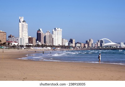"""DURBAN, SOUTH AFRICA - DECEMBER 18, 2014: Many unknown people on South Beach against """"Golden Mile"""" city skyline in Durban, South Africa"""
