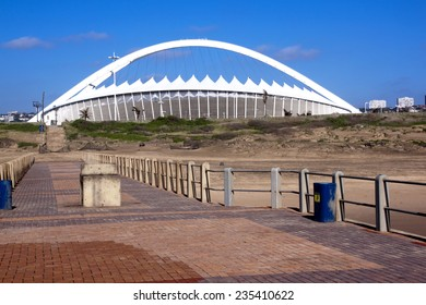 DURBAN; SOUTH AFRICA - DECEMBER 4; 2014 : Moses Mabhida stadium viewed from pier on North beach in Durban South Africa