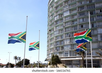 DURBAN, SOUTH AFRICA - DECEMBER 6, 2013: South African flags flying at half-mast in honor of Nelson Mandela in Durban, South Africa, December 6, 2013.