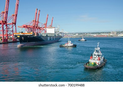 Durban, South Africa - February 04: Container vessels moor in the port of Durban on February 04, 2016  in Durban, South Africa.
