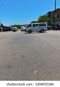 Durban, South Africa - February 2019: Image taken from the street while crossing the road of taxi moving and car waiting in the city centre of Durban