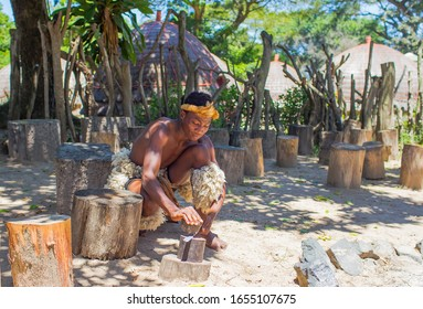 DURBAN- SOUTH AFRICA- JANUARY 15, 2020: Zulus continue their traditions in the Cultural Zulu villages in Kwazulu Natal. A Zulu warrior appears in the photo.