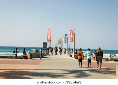 DURBAN - SOUTH AFRICA - July 02, 2017: Locals and tourists at the Millennium Pier in Umhlanga Rocks Beach in Durban. Great views into the ocean especially when wild weather .