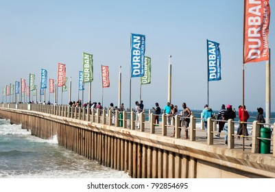 DURBAN - SOUTH AFRICA - July 02, 2017: Tourists and locals enjoying sun over Indian ocean on Umhlanga Rocks Pier in Durban