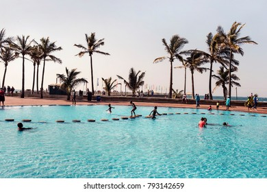 DURBAN, SOUTH AFRICA - July 02, 2017: Children playing in public pools near promenade of Golden Mile Beach on Durban, South Africa