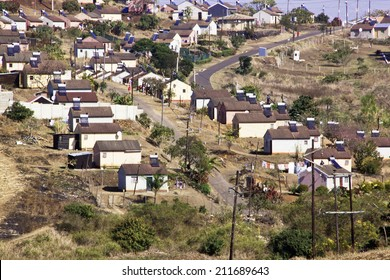 DURBAN, SOUTH AFRICA - JULY 23, 2014: Above view of Low cost township houses fitted with solar heating panels in Verulum in Durban, South Africa