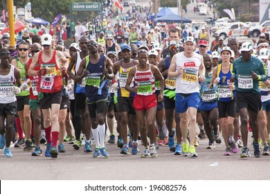 DURBAN, SOUTH AFRICA - JUNE 1, 2014: Crowd of runners competing in the long distance Comrades Marathon between Pietermaritzburg and Durban in South Africa.