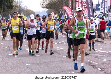 DURBAN, SOUTH AFRICA - JUNE 1, 2014: Many Unknown runners competing in the long distance Comrades Marathon between Pietermaritzburg and Durban in South Africa.
