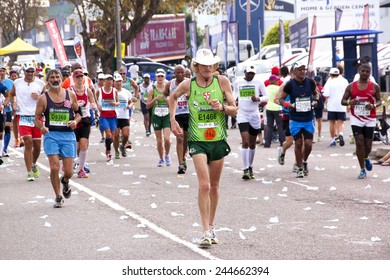 DURBAN, SOUTH AFRICA - JUNE 1, 2014: Spectators and Many runners competing in the long distance Comrades Marathon between Pietermaritzburg and Durban in South Africa.