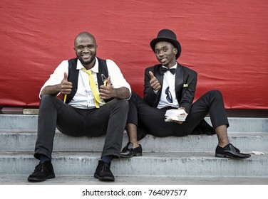 DURBAN, SOUTH AFRICA â?? June 1, 2017: Two young men in happy mood at the Durban July Horserace in South Africa.