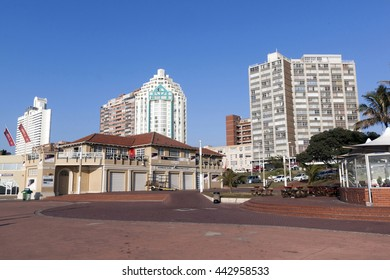 DURBAN, SOUTH AFRICA - JUNE 24, 2016: Early morning  empty beach front paved promenade against Golden Mile city skyline in Durban, South Africa