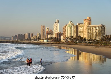 DURBAN, SOUTH AFRICA - June 6 , 2017: Unknown people enjoy early morning sunshine against city skyline in Durban, South Africa