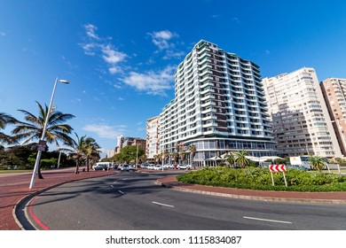 DURBAN, SOUTH AFRICA - MARCH 12 , 2018: Empty promenade and roundabout  against blue cloudy Durban beachfront cityscape in South Africa