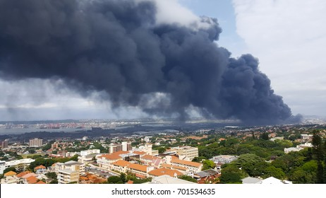 DURBAN, SOUTH AFRICA - March 24 2017- A massive blaze from a factory in Durban with large black plumes of smoke, took firefighters 3 days to extinguish.