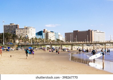 DURBAN, SOUTH AFRICA : MARCH 28, 2016: Many unknown people at Vetch's pier against city skyline in Durban South Africa