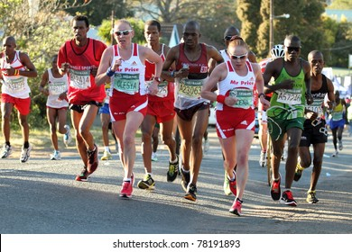 DURBAN, SOUTH AFRICA - MAY 29: Twin sisters Olesya and Elena Nurgalieva (in sunglasses) lead the womens race in the 2011 Comrades Marathon in Durban South Africa on the May 29, 2011.