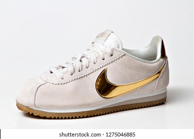 DURBAN, SOUTH AFRICA -  Nike Cortez sneaker with a golden swoosh. Nike s an American multinational corporation that is engaged in the design, development, & manufacturing, of sports apparel. Editorial