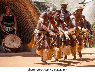 DURBAN, SOUTH AFRICA - OCTOBER 25, 2017:  There are still traditional zulu villages near the city of Durban in KwaZulu Natal. Many tourists from all over the world visit these traditional villages.