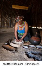 DURBAN, SOUTH AFRICA - OCTOBER 25, 2017: Elderly woman in the traditional Zulu villages of KwaZulu natal, the center of interest of tourists