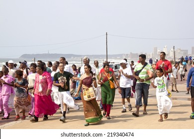 DURBAN, SOUTH AFRICA - SEPTEMBER 24, 2014: DURBAN, SOUTH AFRICA - SEPTEMBER 24, 2014: Many unknown National Heritage Day Walk participants walk along beachfront promenade in Durban, South Africa