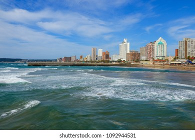 """Durban's """"Golden Mile"""" beachfront as seen from from the Indian Ocean with waves, KwaZulu-Natal province of South Africa"""