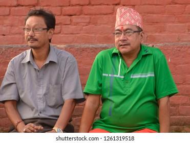 Durbar Square, Katmandu, Nepal-O8 Oct 2014: Two Nepali men enjoying evening time in Durbar square of Nepal, Katmandu.