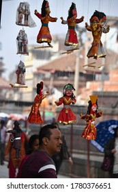 DURBAR SQUARE, NEPAL - APRIL 16,2019: The Nepalese culture art design of Nepal ese puppet souvenirs in the area of Durbar square, Kathmandu