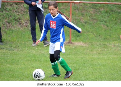 DURCINA, SLOVAKIA - APRIL 27, 2019: Summer soccer tournament for young kids (category U11) organized by football club FK Durcina. Matches full of emotions and joy of the game. Young football girl.