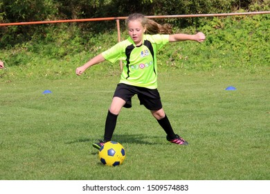 DURCINA, SLOVAKIA - SEPTEMBER 29, 2018: Summer soccer tournament for young kids (category U11) organized by football club FK Durcina. Matches full of emotions and joy of the game. Young football girl.