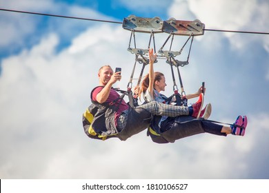 Durdevica Tara / Montenegro - september 2018:Zip Line with two young people. Romantic couple take a selfie on the zipline