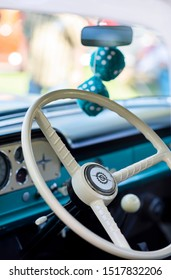 Durham, California / USA - 9/15/19: steering wheel in blue and white retro car, interior of vintage automobile, restored old car at show, fuzzy dice