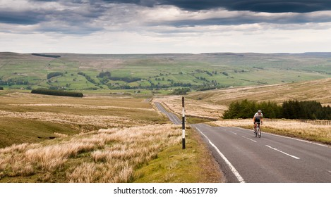 Durham, England - May 25, 2011: A road cyclist climbs Chapel Fell, the hill dividing Weardale and Teesdale in England's remote North Pennines hills.