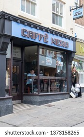 Durham / Great Britain - March 02, 2019 : Exterior of Caffe Nero coffee shop cafe showing sign, signage, logo and branding