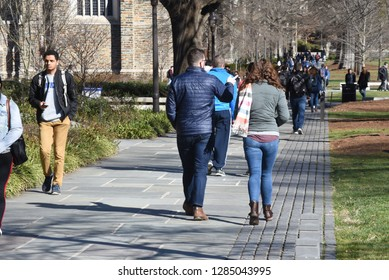 Durham, NC/United States- 01/13/2018: College students at Duke University stroll across campus on a chilly morning.