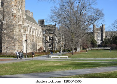 Durham, NC/United States- 01/13/2018:  Students walk across west campus on a cold morning. The architecture at Duke University is a fine example of the Collegiate Gothic style.