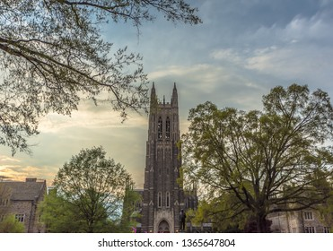 Durham , North Carolina / USA - April 07 2019 :  Building of Duke University Chapel is Interdenominational campus church featuring a sizable tower,Sunset time.