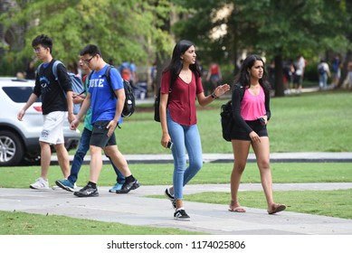 Durham, North Carolina/United States- 09/06/2018: A diverse group of students walk across campus of Duke University on a humid morning.