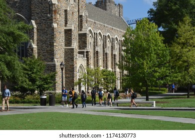 Durham, North Carolina/United States- 09/07/2018: College students walk amongst beautiful buildings built in the  collegiate gothic architectural style.