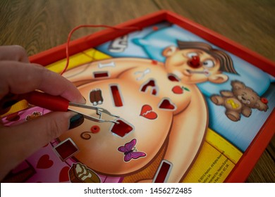 Durham, UK - 20th July 2019: Operation Hasbro board game. Gameplay requires players to remove these plastic ailments with a pair of tweezers. Medical NHS doctor nurse heart operation concept