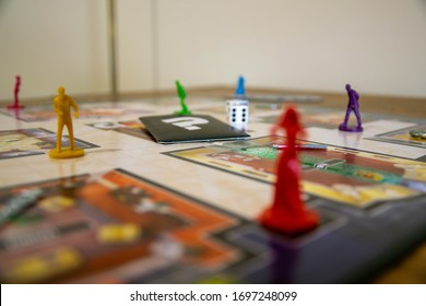 Durham, UK - 5 April 2020: Cluedo is a classic murder mystery detective board game first manufactured by Waddington's, currently owned by Hasbro. Crime, whodunit, police concept. Family fun background