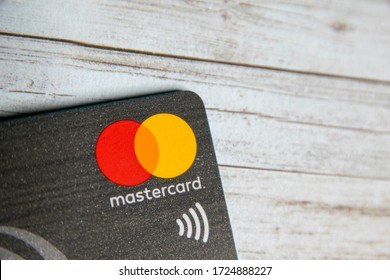 Durham, UK - 7 May 20: Plastic contactless credit card with Mastercard symbol. Mastercard is an American multinational financial services with payments widely accepted globally