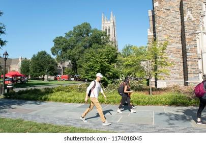 Durham,North Carolina/United States- 09/07/2018: Students at Duke University walk across campus with Duke Chapel in the background.
