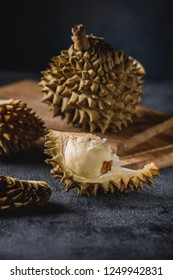 Durian exotic fruit from Asia. Pieces of cut fruit on table. Sweet flesh